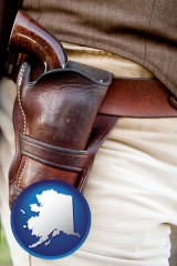 alaska map icon and a gun in a Western-style, leather holster