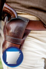 arkansas map icon and a gun in a Western-style, leather holster