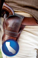 ca a gun in a Western-style, leather holster