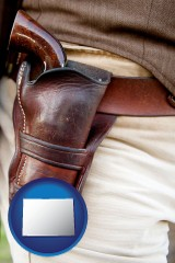 colorado map icon and a gun in a Western-style, leather holster
