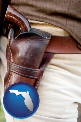 florida map icon and a gun in a Western-style, leather holster