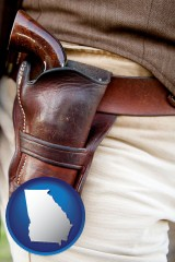 georgia map icon and a gun in a Western-style, leather holster