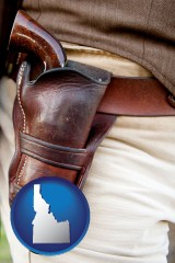 idaho map icon and a gun in a Western-style, leather holster