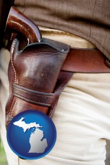 michigan map icon and a gun in a Western-style, leather holster