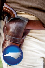 north-carolina map icon and a gun in a Western-style, leather holster