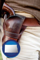 north-dakota map icon and a gun in a Western-style, leather holster
