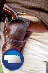 nebraska map icon and a gun in a Western-style, leather holster