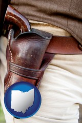 ohio map icon and a gun in a Western-style, leather holster