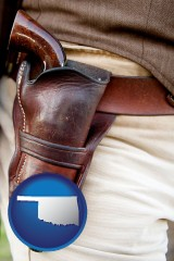 oklahoma map icon and a gun in a Western-style, leather holster