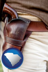 sc a gun in a Western-style, leather holster