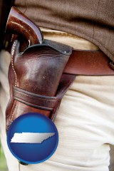 tn a gun in a Western-style, leather holster