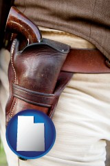 utah map icon and a gun in a Western-style, leather holster