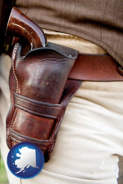 a gun in a Western-style, leather holster - with Alaska icon