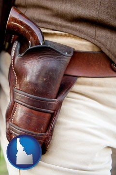 a gun in a Western-style, leather holster - with Idaho icon