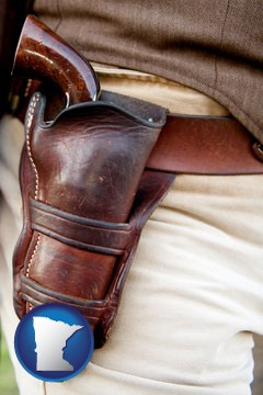 a gun in a Western-style, leather holster - with Minnesota icon