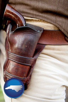a gun in a Western-style, leather holster - with North Carolina icon