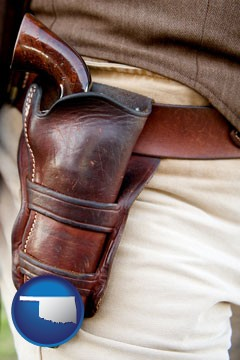 a gun in a Western-style, leather holster - with Oklahoma icon