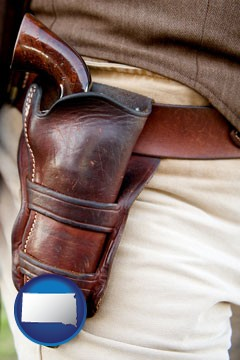 a gun in a Western-style, leather holster - with South Dakota icon