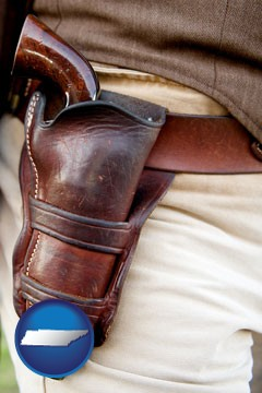 a gun in a Western-style, leather holster - with Tennessee icon