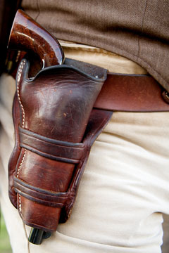 a gun in a Western-style, leather holster